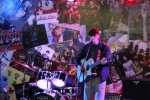 Adam Maloney on stage at Lava Javas