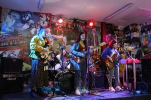 PowPig on stage at Lava Javas